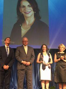 Prof. Rodriguez-Dod pictured receiving her award from President Mark Rosenberg.